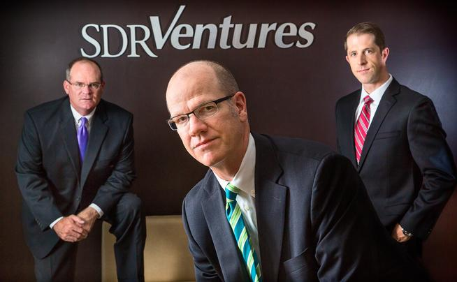 SDR Ventures co-founders Andy Limes, left, and Chris Bouck, center, and director of investment banking Travis Conway.